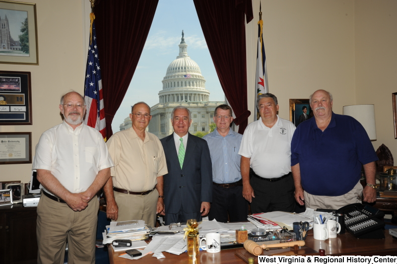 "Congressman Rahall stands in his Washington office with five men, one of whom wears a shirt labeled ""Boone County."""