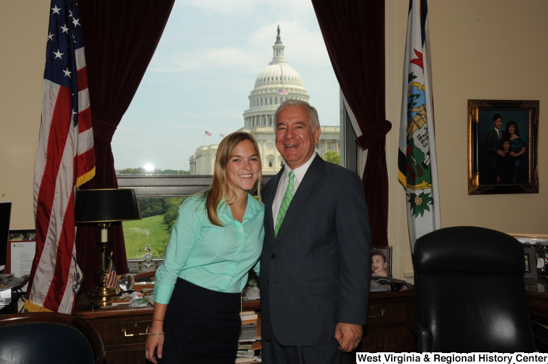 Congressman Rahall stands in his Washington office with a woman wearing a teal shirt.