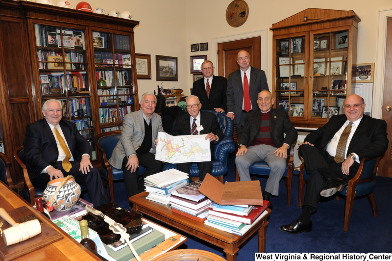 Congressman Rahall in his Washington office sits with six men and a map.