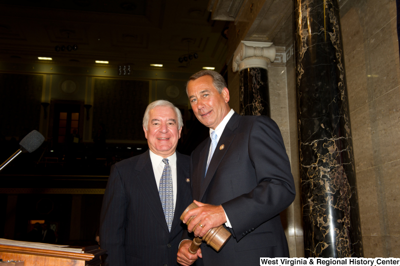 Standing on the House floor are Congressman Rahall and John Boehner, who holds a gavel.