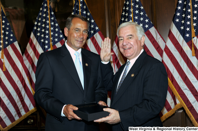 Congressman Rahall poses at a ceremonial swearing-in with John Boehner.