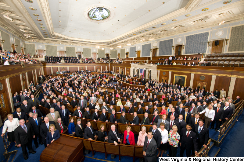 Members of the 112th Congress stand on the House floor (official House portrait photograph).