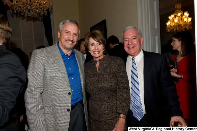 Congressman Rahall stands with Nancy Pelosi and others.