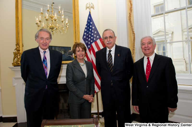 Congressman Rahall stands with Edward Markey, Nancy Pelosi, and another man.