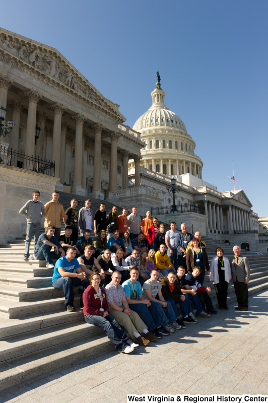 Congressman Rahall stands on the steps of the Capitol Building with teenagers and adults.