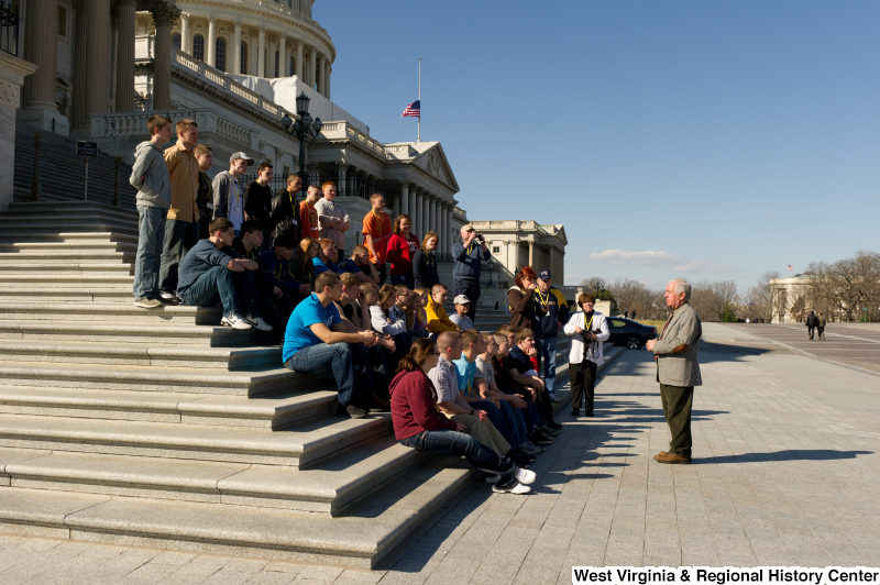 Congressman Rahall speaks to adults and teenagers on the steps of the Capitol Building.