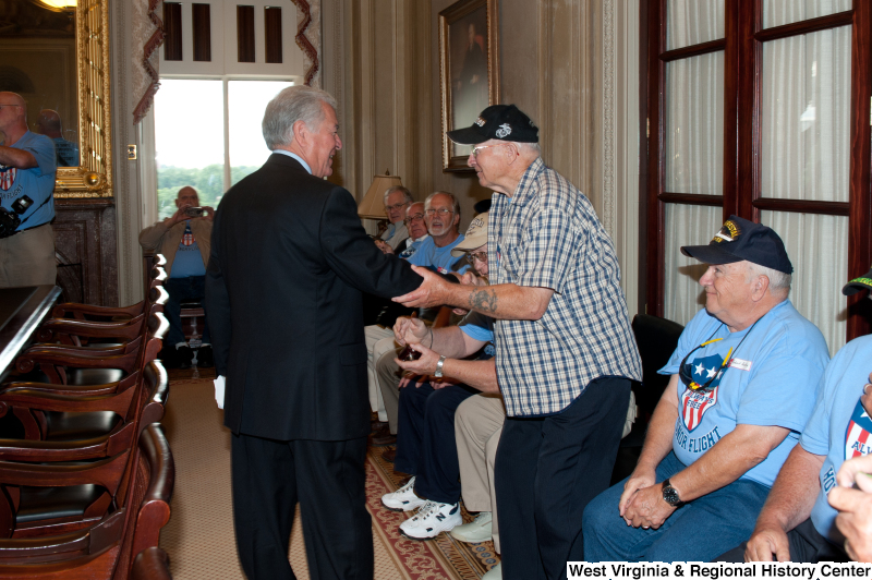 Congressman Rahall meets with men at a military award ceremony.