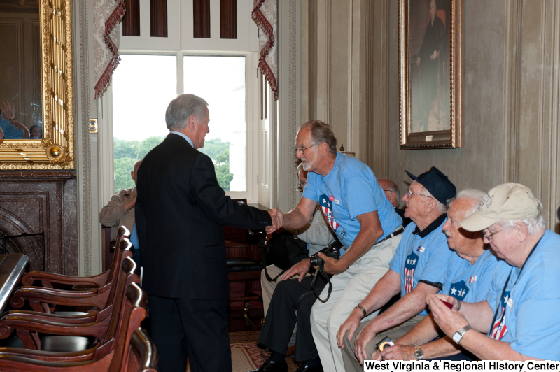 Congressman Rahall shakes hands with men at a military award ceremony.