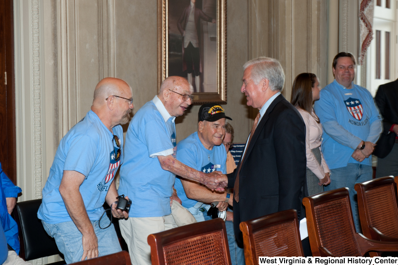 Congressman Rahall meets with other men at a military award ceremony.