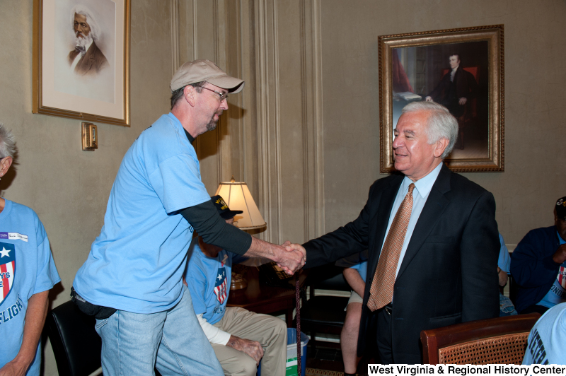 Congressman Rahall meets veterans at a military award ceremony.