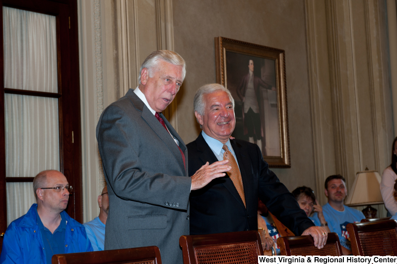 Congressman Rahall and another man speak to veterans at a military award ceremony.