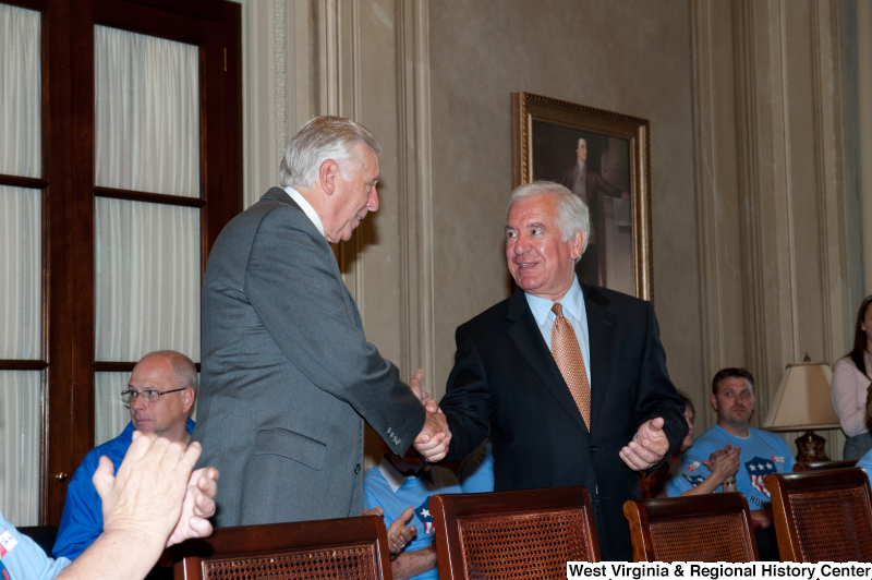 Congressman Rahall shakes hands with another man at a military award ceremony.