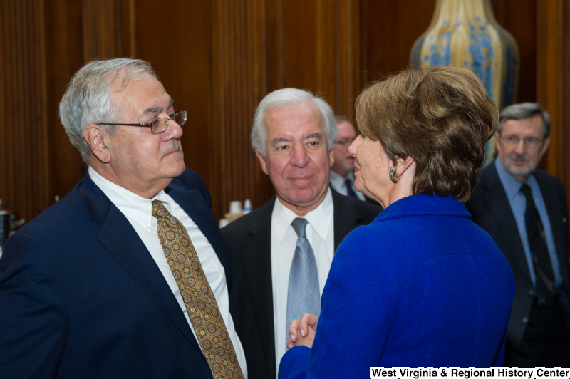 Congressman Rahall, Nancy Pelosi, and Barney Frank gather at a tree-planting reception.