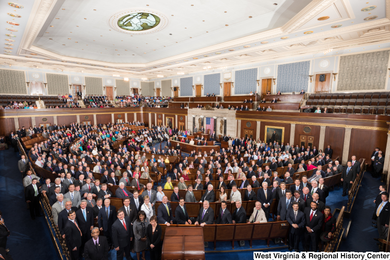 Members of the 113th Congress stand on the floor of the House of Representatives (official portrait photograph).