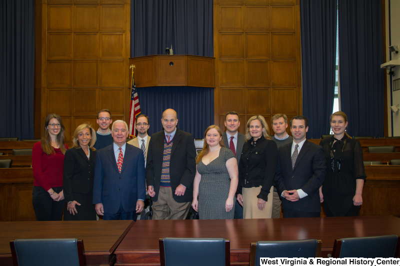 Congressman Rahall and a group of people stand at a conference table.