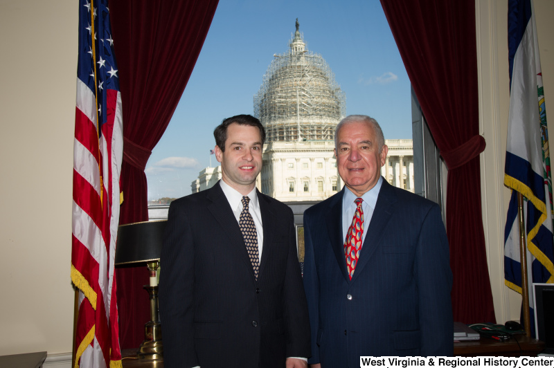 Congressman Rahall stands in his Washington office with a man wearing a dark suit and oval-patterned tie.