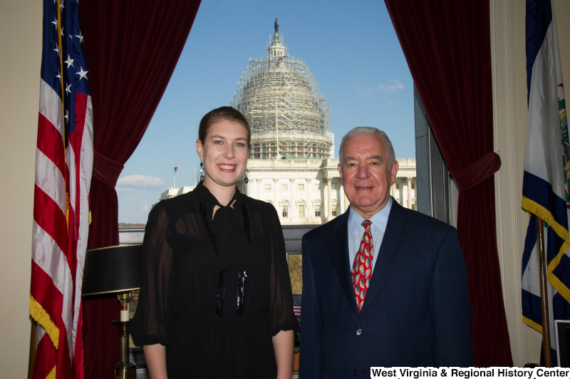 Congressman Rahall stands in his Washington office with a woman wearing a black outfit.